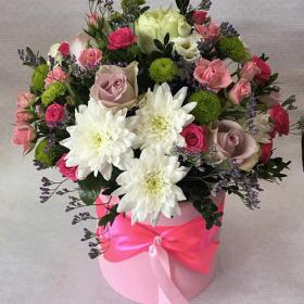 квіти у капелюшній коробці