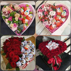 подарункові коробки з квітами та цукерками