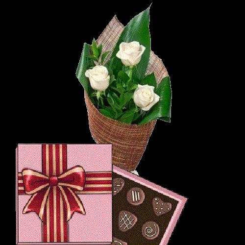 подарунок 3 білі троянди з цукерками