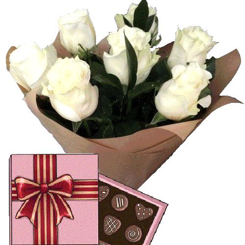 замовлення подарунка 7 білих троянд із цукерками